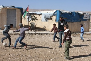 Boys playing football in the Area C village of Fahit.